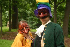 Commedia actors in the woods