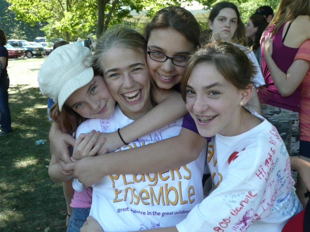 high school and middle school campers hugging