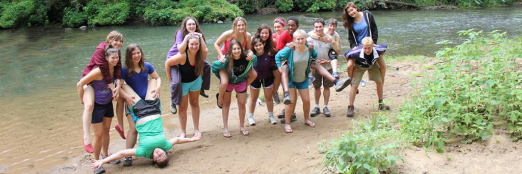 high school theater camp outdoors posing by the water
