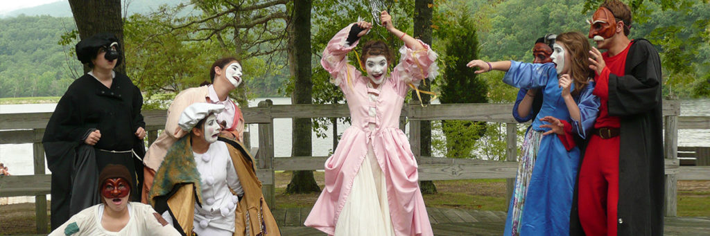 commedia troupe performing outdoors