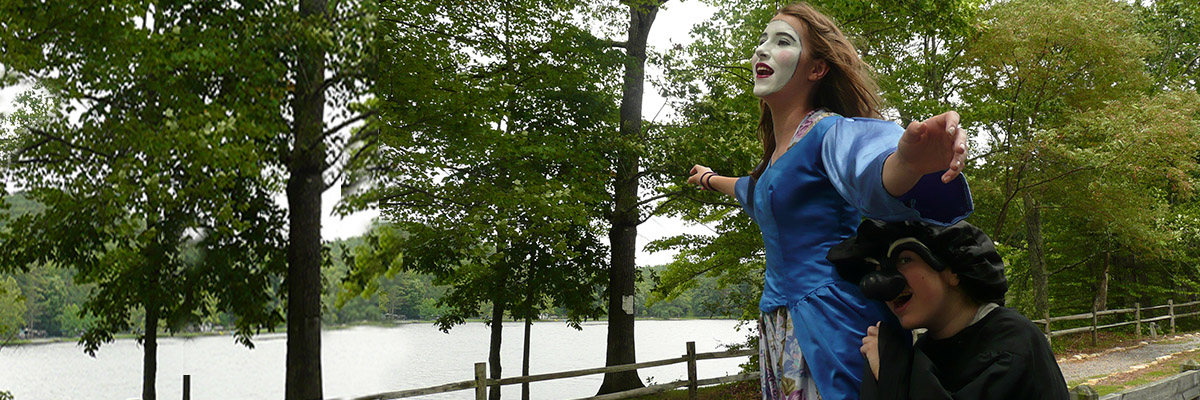 commedia actors by the river