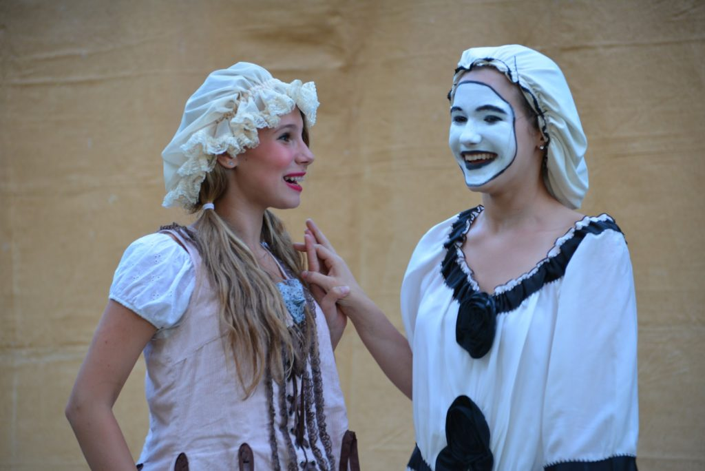 two high school actors in commedia troupe on tour